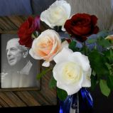 Leonard Cohen with roses