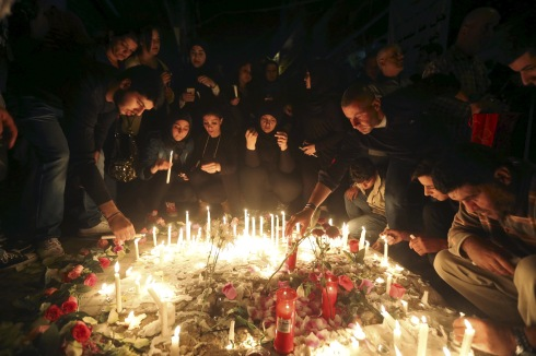 People light candles during a vigil at the site of the two explosions that occurred on Thursday in the southern suburbs of the Lebanese capital Beirut, November 13, 2015. REUTERS/Hasan Shaaban - RTS6U96